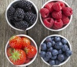 Cups of blackberrys, blueberrys, raspberrys and strawberrys