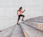 Woman running up steps