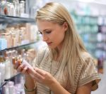 Woman checking Skincare expiry date